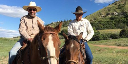 cowboy-cattle-drive-rafter-star-ranch-guest-riding-with-cowboss-cow-camp-Big-horn-mountains-wyoming-dude-ranch
